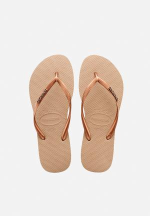 Havaianas Slim Logo Metallic Sandals & Flip Flops Rose Gold