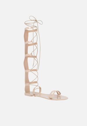 Call It Spring Bedgood Sandals & Flip Flops Nude